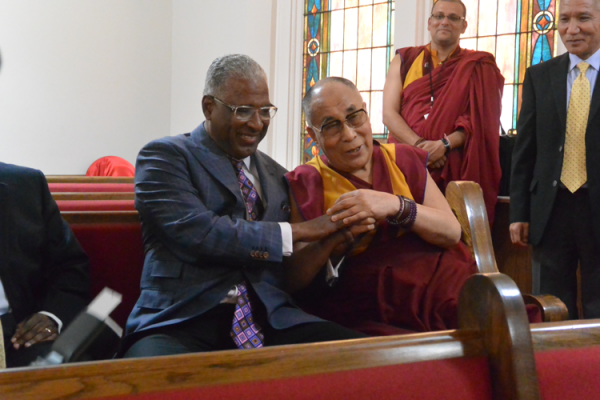 The Dalai Lama held Mayor William Bell's hands throughout the press conference to express his gratitude for the invitation.